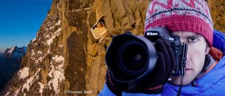 Bildmontage - Fotograf mit Kamera, im Hintergrund Mann im Portaledge